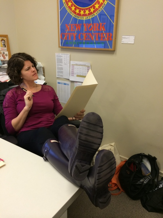 Erin Stine is kicking back, putting her feet up and reading applications thoughtfully.