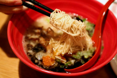 "The signature Akamaru Modern includes their silky Tonkatsu soup noodles topped with their secret ""Umami Dama"" miso paste, pork chashu, cabage, sesame kikurage mushrooms, scallions, and fragrant garlic oil"