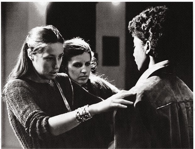A young Donna Karan checks the fit of her design on a model at Parsons