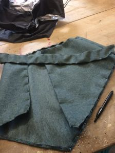 The man skirt pinned together after an hour of poking myself and nearly bleeding onto my project.